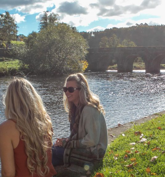 Girls sitting on River bed Inistioge, Kilkenny, Ireland